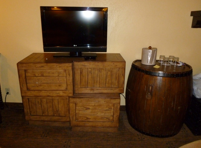 Those crates are actually drawers, and the barrel is a mini fridge.